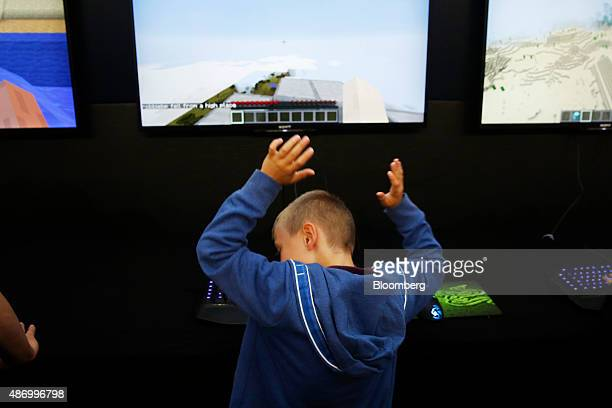 A visitor reacts as he plays the PC version of Minecraft at the Legends of Gaming Live event in London on Saturday Sept 5 2015 The Sterling suffered...