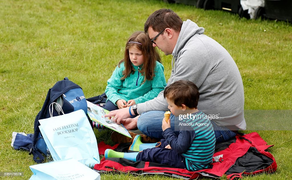 A visitor reads a book at the Hay Festival, on May 29, 2016 in Hay-on-Wye, Wales.The Hay Festival is an annual festival of literature and arts now in its 29th year.