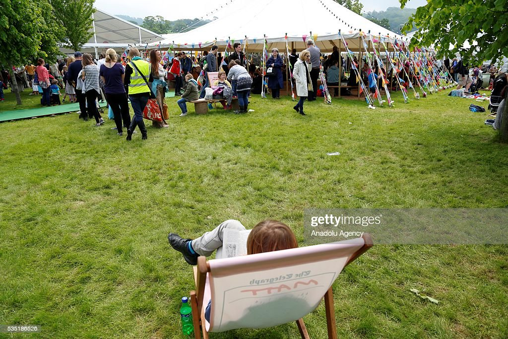A visitor reads a book at the Hay Festival, on May 29, 2016 in Hay-on-Wye, Wales. The Hay Festival is an annual festival of literature and arts now in its 29th year.
