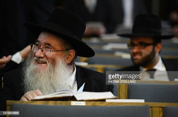 A visitor reads a book prior to a ceremony to ordain four rabbis at the synagogue in Cologne western Germany on September 13 2012 The ordination of...