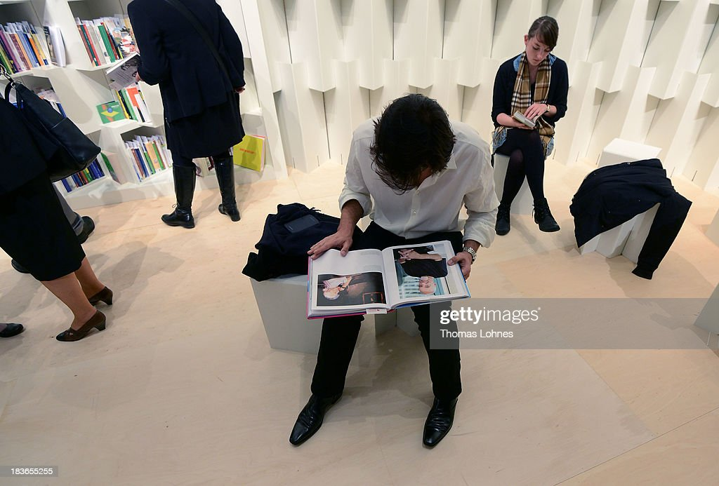 A visitor reads a illustrated book during the opening ceremony of the Brazil exhibition of the 2013 Frankfurt Book Fair on October 8, 2013 in Frankfurt, Germany. This year's fair will be open to the public from October 9-13 and the official partner nation is Brazil.