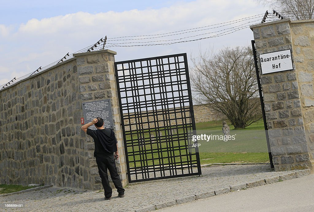 A visitor reads a sign at the World War II concentration camp of Mauthausen, on April 17, 2013.