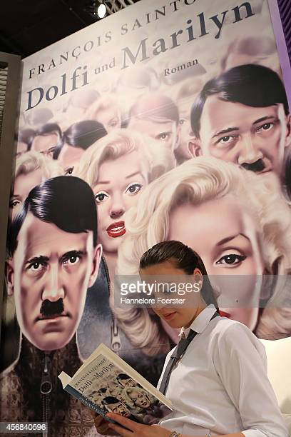 A visitor reads the book Dolfi Marilyn at the 2014 Frankfurt Book Fair on October 8 2014 in Frankfurt Germany The 2014 fair which is among the...
