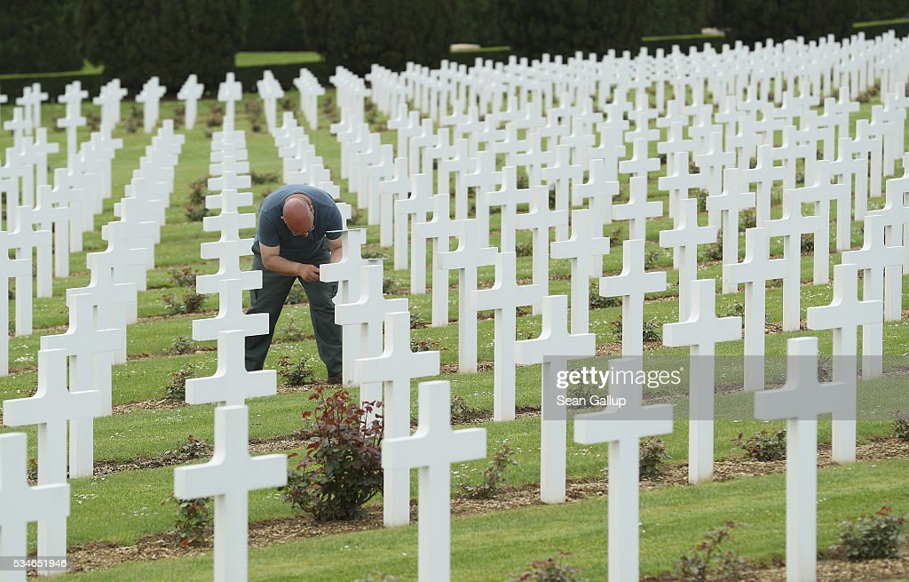 A visitor replaces a plaque that had a factual error among the thousands of crosses marking the graves of French soldiers killed in the Battle of Verdun at the ossuary of Douaumont on May 27, 2016 in Verdun, France. The governments of France and Germany will commemorate the 100th anniversary of the battle with ceremonies this coming Sunday. Approximately 300,000 soldiers lost their lives in the 10-month campaign that was among the most grueling battles of the war.