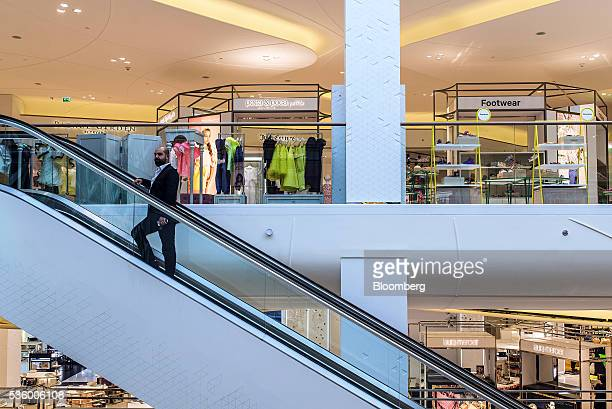 A visitor rides an empty escalator between floors at the Yas Island Mall in Abu Dhabi United Arab Emirates on Monday May 30 2016 Abu Dhabi which sits...