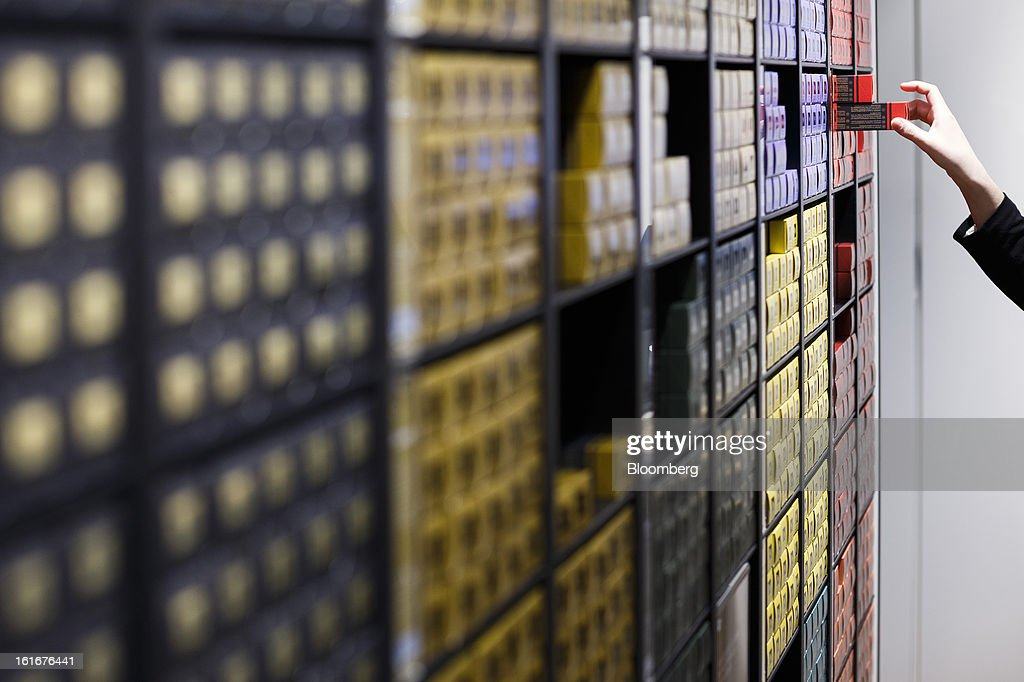 A visitor selects a carton from a display of Nespresso coffee inside a store at the Nestle SA headquarters in Vevey, Switzerland, on Thursday, Feb. 14, 2013. Nestle SA said it expects 2013 to be as challenging as last year, when sales missed analysts' estimates on a slowdown in emerging markets, a region the world's largest food company is increasingly dependent upon. Photographer: Valentin Flauraud/Bloomberg via Getty Images