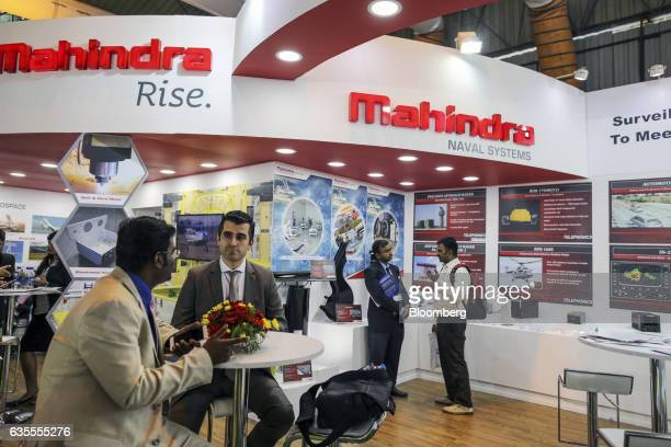 Visitor sit at the Mahindra Defence Naval Systems Pvt booth during the Aero India air show at Air Force Station Yelahanka in Bengaluru India on...