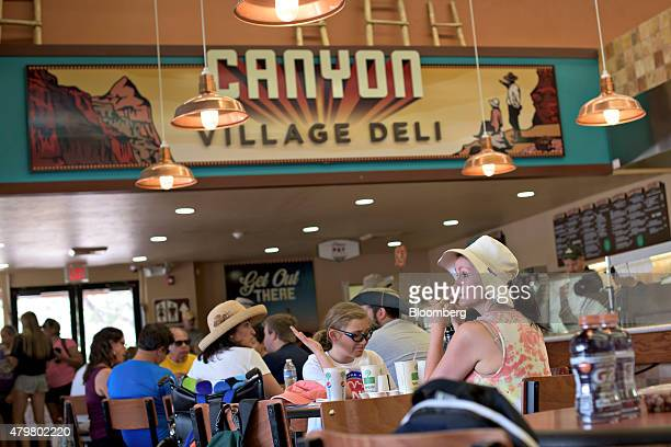 A visitor sits at a dining table in the Canyon Village Deli at Grand Canyon National Park in Grand Canyon Arizona US on Thursday June 25 2015 The...