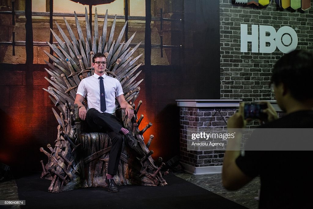A visitor sits on the throne at the Game of Thrones area during the Bangkok Comic Con 2016 Festival at Bitec Exhibition Centre in Bangkok, Thailand on April 29, 2016. 'Cosplay' imitates characters from comics, video games, anime series and science fiction movies, mostly coming from the Japanese pop culture. Bangkok Comic Con is one of the biggest Pop Culture exhibition in Asia starts from 29 April until 1 May 2016. The event hopes to turn Thailand into a major center for international filmmakers and animators come to create their masterpieces. Comic Con is an internationally renowned event in the world of animation as it started in 1970 in San Diego.