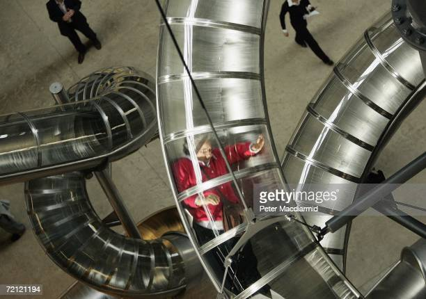 A visitor slides down artist Carsten Holler's installation entitled 'Test Site' at The Tate Modern on October 9 2006 in London The work for the...