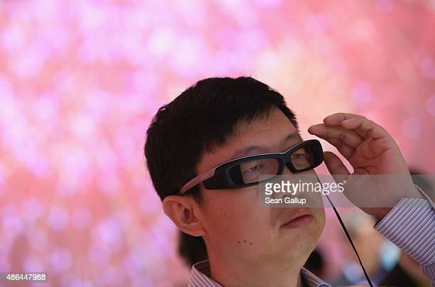 A visitor SmartEyeglass at the Sony stand at the 2015 IFA consumer electronics and appliances trade fair on September 4 2015 in Berlin Germany The...