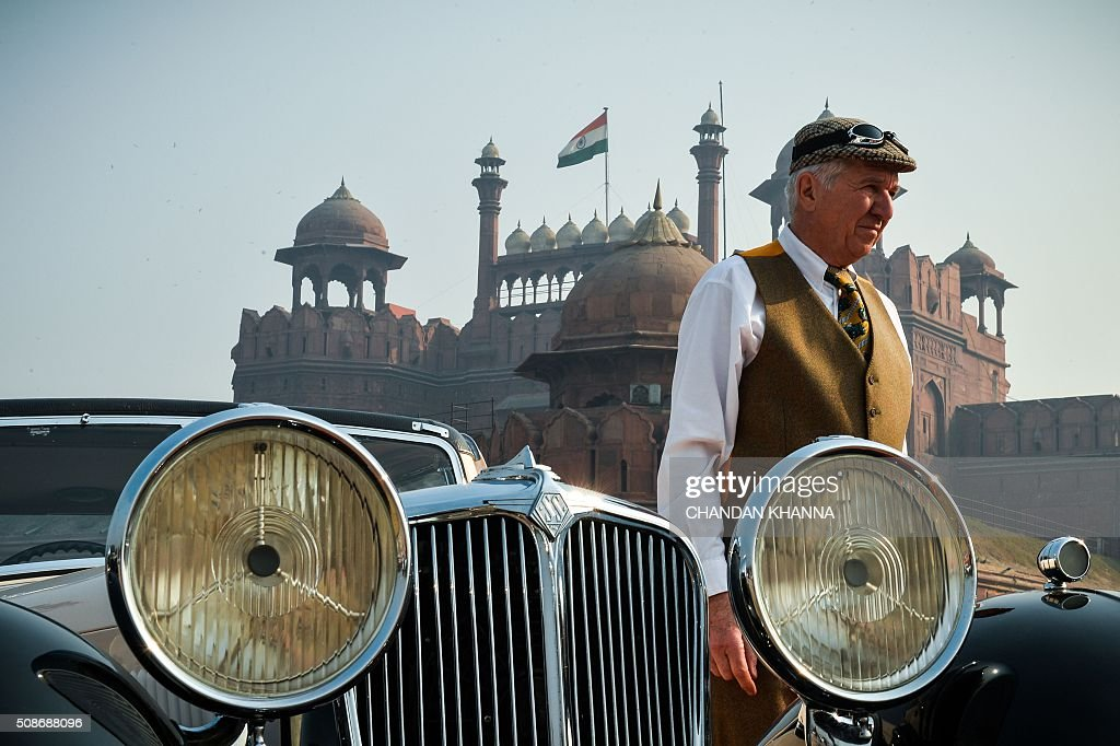 A visitor stand next to a 1933 Jaguar SS coupe at the 6th 21 Gun Salute International Vintage Car Rally in New Delhi on February 6, 2016. The two-day event ends February 7. AFP PHOTO / CHANDAN KHANNA / AFP / Chandan Khanna