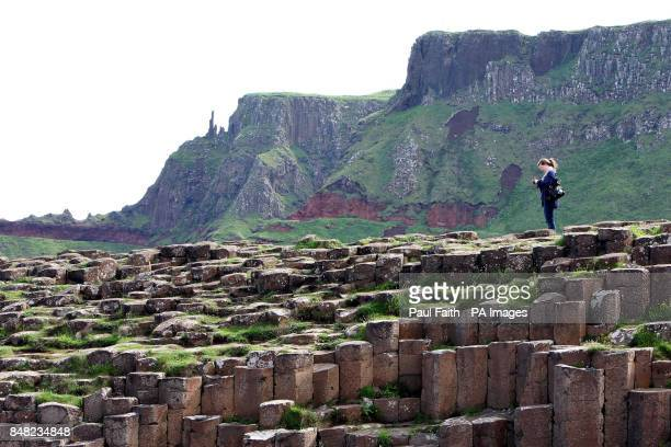 A visitor stands at the Giant's Causeway County Antrim ahead of the opening of the new pound185m visitors' centre