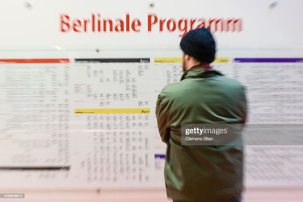 A visitor stands in front of a Berlinale program schedule near the festival site prior to the 66th Berlinale on February 7, 2016 in Berlin, Germany.