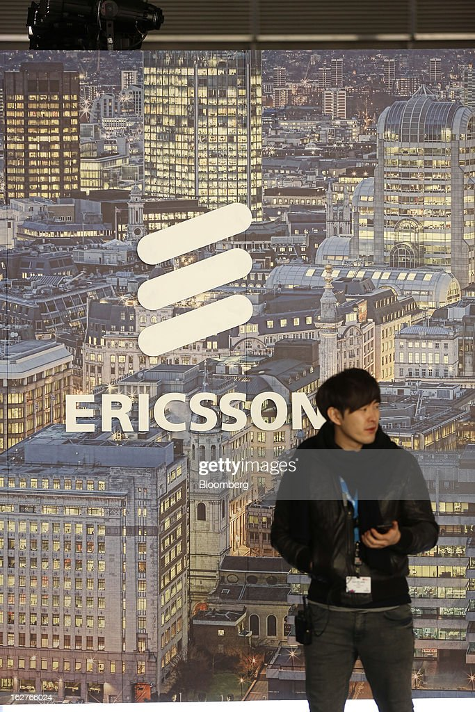A visitor stands in front of a logo outside the Ericsson AB pavilion at the Mobile World Congress in Barcelona, Spain, on Tuesday, Feb. 26, 2013. The Mobile World Congress, where 1,500 exhibitors converge to discuss the future of wireless communication, is a global showcase for the mobile technology industry and runs from Feb. 25 through Feb. 28. Photographer: Simon Dawson/Bloomberg via Getty Images