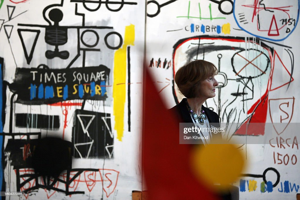 A visitor stands in front of a painting by Jean-Michel Basquiat entitled 'Five Fish Species,' on January 31, 2013 in London, England. The triptych painting is estimated to sell for between £4.25-6.25 Million GBP when it goes on sale at the 'Contemporary Art' evening sale at Sotheby's auction house on February 5, 2013.