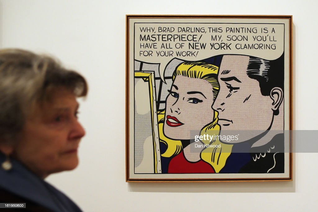 A visitor stands in front of a painting entitled 'Masterpiece,' during a press preview of 'Lichtenstein, a Retrospective' at the Tate Modern on February 18, 2013 in London, England. The painting is part of a retrospective exhibition by 1960's Pop Artist Roy Lichtenstein, the first of its kind in 20 years, which runs at the gallery until May 27, 2013.