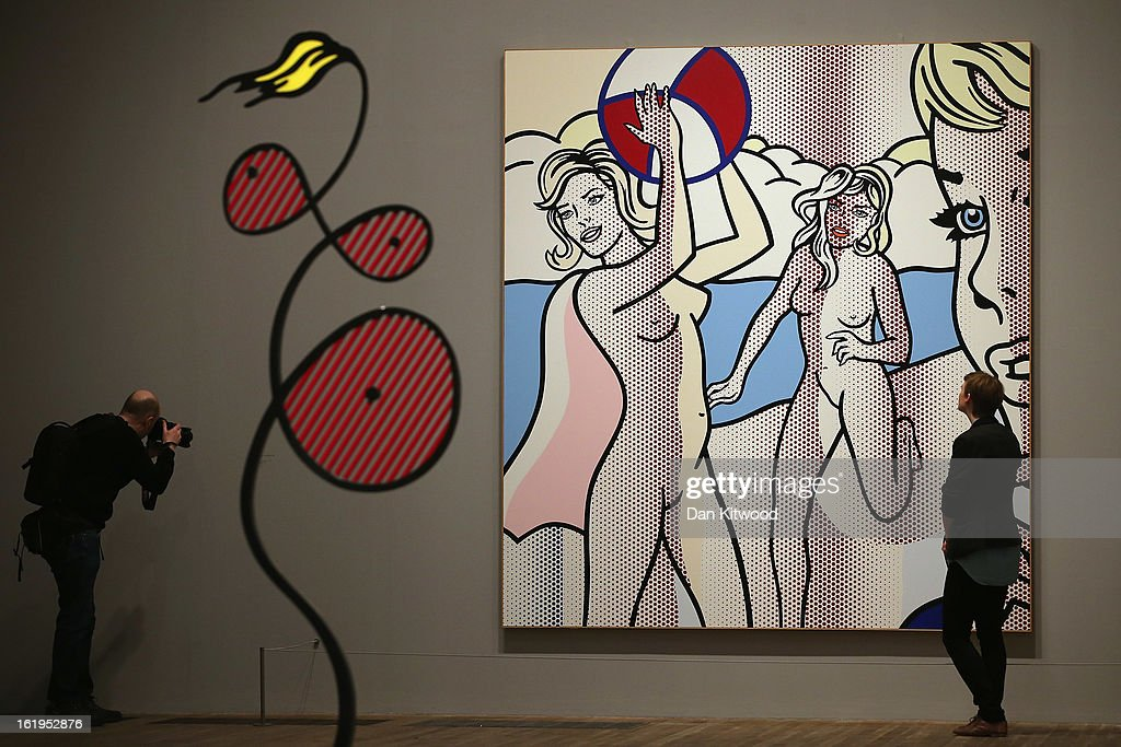 A visitor stands in front of a painting entitled 'Nudes with Beach Ball,' during a press preview of 'Lichtenstein, a Retrospective' at the Tate Modern on February 18, 2013 in London, England. The painting is part of a retrospective exhibition by 1960's Pop Artist Roy Lichtenstein, the first of its kind in 20 years, which runs at the gallery until May 27, 2013.