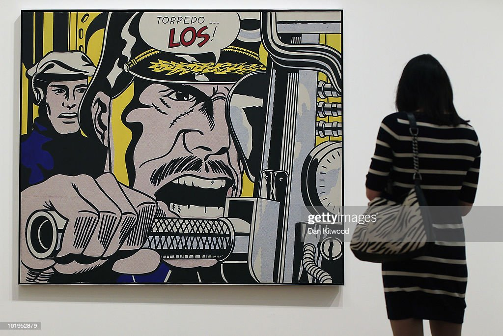 A visitor stands in front of a painting entitled 'Torpedo Los,' during a press preview of 'Lichtenstein, a Retrospective' at the Tate Modern on February 18, 2013 in London, England. The painting is part of a retrospective exhibition by 1960's Pop Artist Roy Lichtenstein, the first of its kind in 20 years. The show runs at the gallery until May 27, 2013.