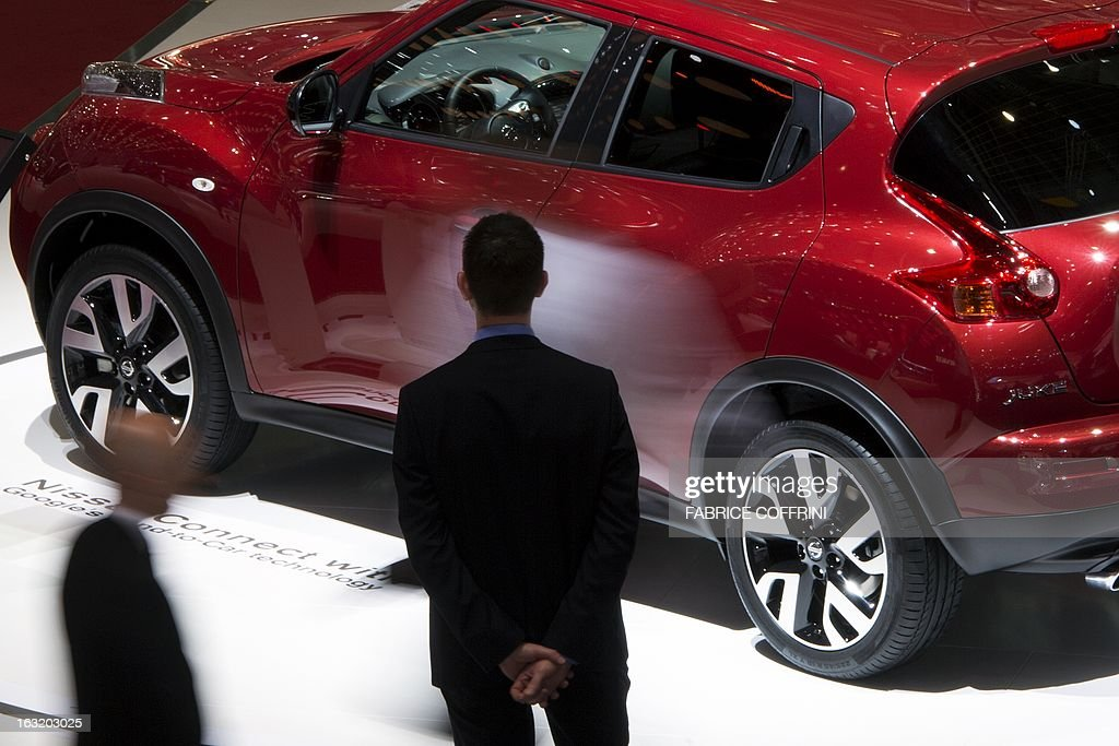 A visitor stands in front of a SUV model car at the booth of Japanese carmaker Nissan at the Geneva International Motor Show on March 6, 2013. Global sales of cars, buses, utility vehicles and trucks are expected to grow three percent this year, down from five percent in 2012, according to a forecast published on March 6, 2013. The growth forecast, presented by the International Organisation of Motor Vehicle Manufacturers (OICA) at the Geneva Motor Show, is based on figures provided by the national car federations in three quarters of OICA member countries.
