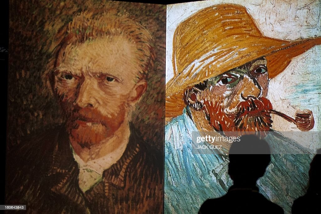 A visitor stands in front of giant screens featuring images of the work of Dutch painter Vincent van Gogh during a traveling multimedia art exhibition entitled 'Van Gogh alive' on February 4, 2013 at the Israel Trade Fairs and Convention Center in Tel Aviv. The interactive installation, featuring thousands of 360-degree lifelike images of Van Gogh's works, has already toured Turkey, Singapore and the United States and will take place in Tel Aviv until March 4, 2013.