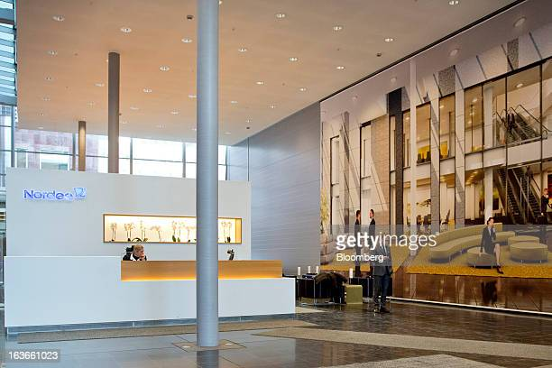 A visitor stands in the foyer of the headquarters of Nordea Bank SA in Stockholm Sweden on Wednesday March 13 2013 Nordea probably will generate...