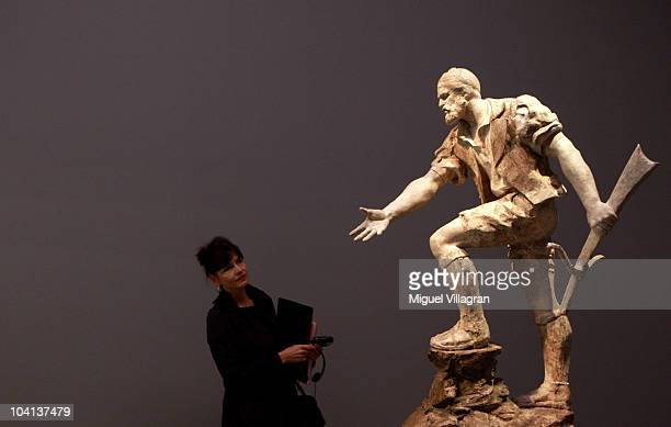 A visitor stands infront of a sculpture depicting Wilhelm Tell by Auguste de Niederhaeusern during the press day of the exhibition Giacometti Hodler...