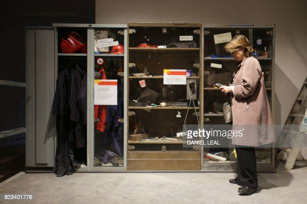 01 GMT / A visitor stands next to a display cabinet with workers belongings untouched since the 30th May 2003 the last day for workers at the Rail...