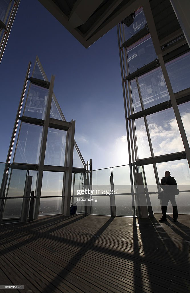 A visitor stands on a platform at 'The View From The Shard', a series of viewing galleries near the top of the Shard tower, in London, U.K., on Wednesday, Jan. 9, 2013. The Shard, which stands at 309.6 meters on London's South Bank, is owned by LBQ Ltd., which brings together the State of Qatar (the majority shareholder) and Sellar Property Group Ltd., with non-equity funding by Qatar National Bank. Photographer: Chris Ratcliffe/Bloomberg via Getty Images