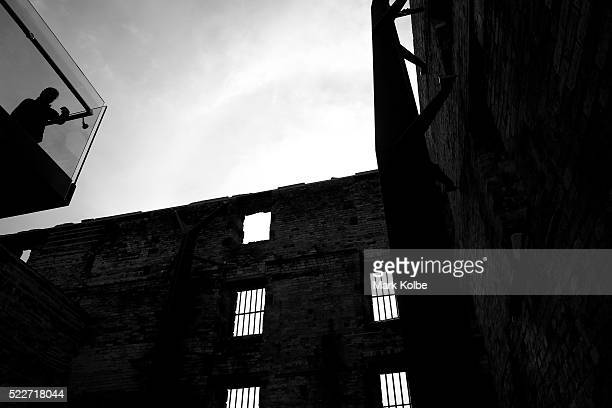 A visitor stands on the viewing platform built within the Penitentiary of the Port Arthur Historical Site on April 18 2016 in Port Arthur Australia...