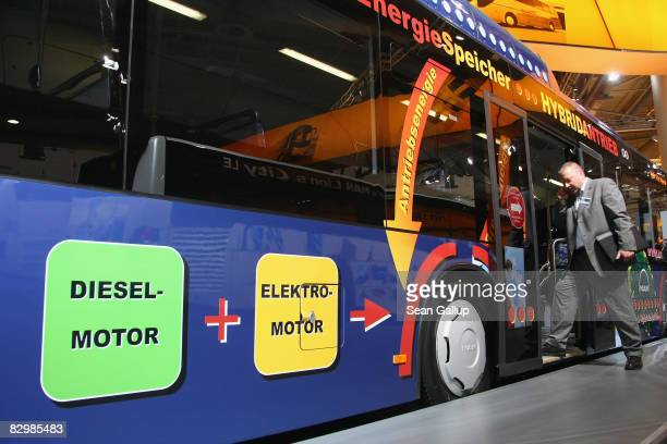 A visitor steps into a hybrid MAN city bus during a media and industry professionals' day at the IAA Commercial Vehicles trade fair on September 24...