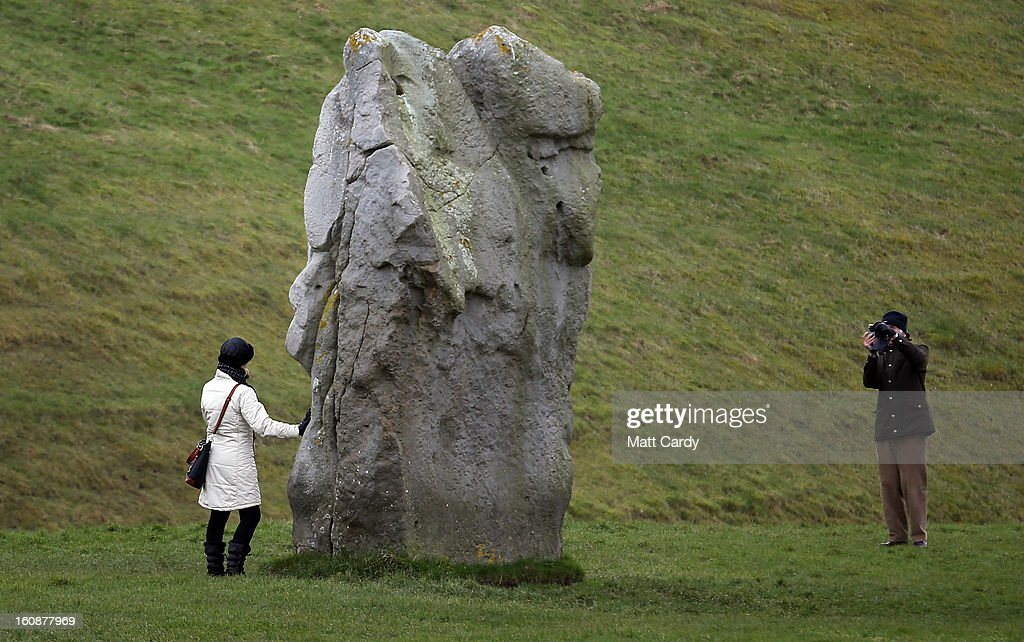A visitor stops to take a photograph besides the Neolithic stones at Avebury on February 7, 2013 in Wiltshire, England. A leading travel magazine has recently named the collection of stones - thought to have been constructed around 2600BC and the largest stone circle in Europe, as the second best heritage site in the world. The Wiltshire world heritage site has been placed ahead of much more recognisable sites including the Valley of the Kings in Egypt, Taj Mahal in India and the Forbidden City in China.