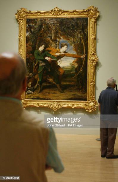 A visitor studies 'The Archers' a painting by Sir Joshua Reynolds which has just been acquired by the Tate Britain Gallery in Central London this...