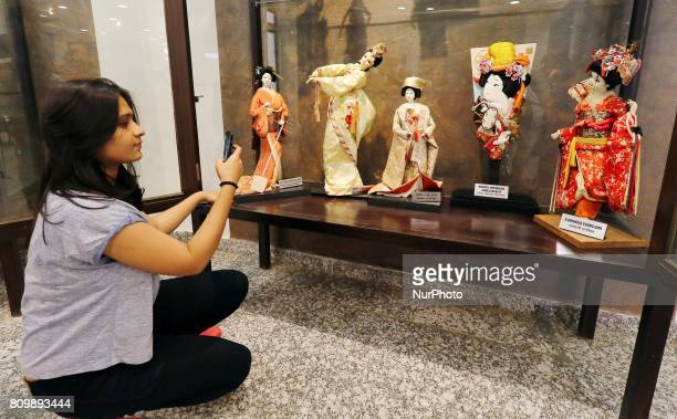A visitor take pictures of various nations dolls which put on display at the Dolls Museum as it reopened for public in Jaipur Rajasthan India...