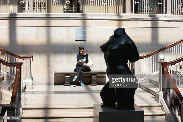 A visitor takes a break while viewing the collection at the Art Institute of Chicago on September 17 2014 in Chicago Illinois The museum which draws...
