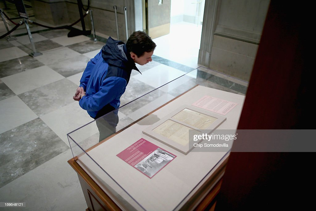 A visitor takes a close look at two hand-written pages from President George Washington's inaugural address that are on exhibit at the National Archives January 15, 2013 in Washington, DC. The first president of the United States, Washington delivered the eight-page address before a meeting of Congress April 30, 1789 in New York City, the temporary seat of the newly-formed federal government.