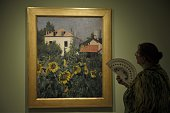 A visitor takes a look at Caillebotte's 'Sunflowers Garden at Petit Gennevilliers' during the press preview of the exhibition 'Caillebotte pintor y...