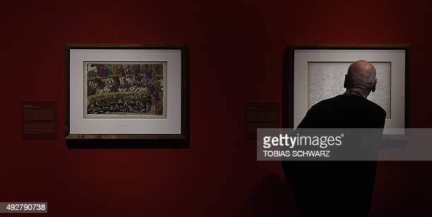 A visitor takes a look at works by Italian painter Sandro Botticelli during a press preview of the exhibition 'Der Botticelli Coup Schaetze der...