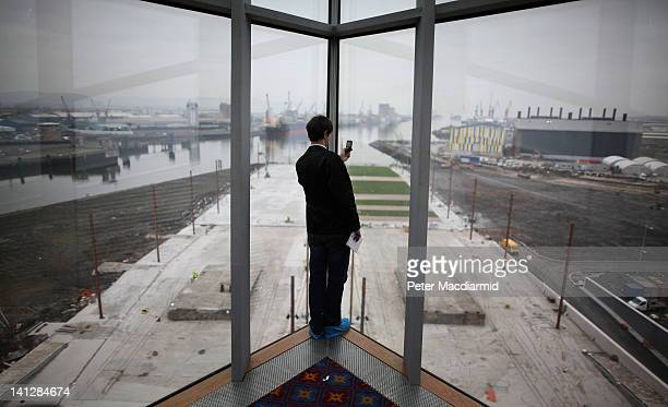 A visitor takes a phone picture of the slipway at the Titanic Belfast attraction on March 13 2012 in Belfast Northern Ireland The Titanic Belfast...