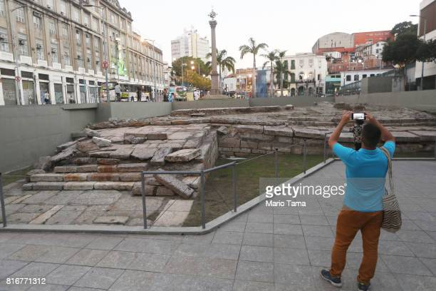 A visitor takes a photo at the Valongo slave wharf entry point in the Americas for nearly one million African slaves on July 17 2017 in Rio de...