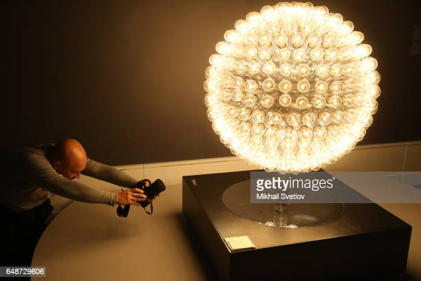 A visitor takes a photo of Otto Plein's 'Corona Borealis' is seen at the PostWar European Art Exhibition at Pushkin Museum in Moscow Russia March 6...