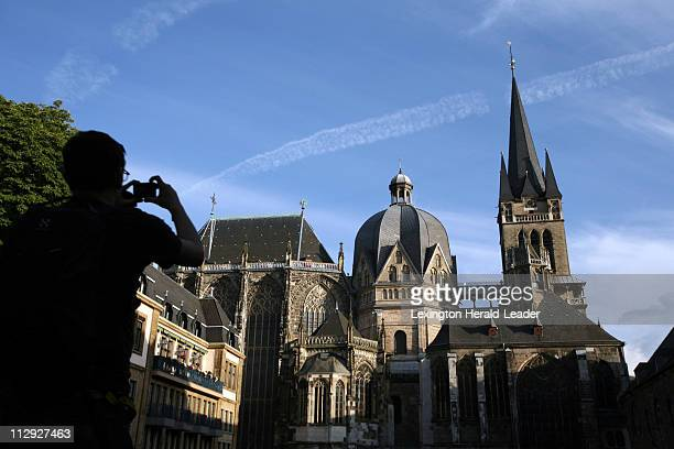 A visitor takes a photo of the Cathedral of Aachen pictured during the CHIO World Equestrian Festival in Aachen Germany July 6 2007 The church...