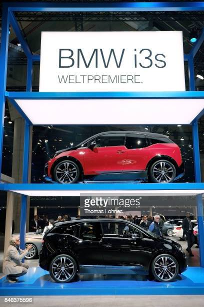 A visitor takes a picture of a BMW I3s at the 2017 Frankfurt Auto Show 'Internationale Automobil Ausstellung' on September 13 2017 in Frankfurt am...
