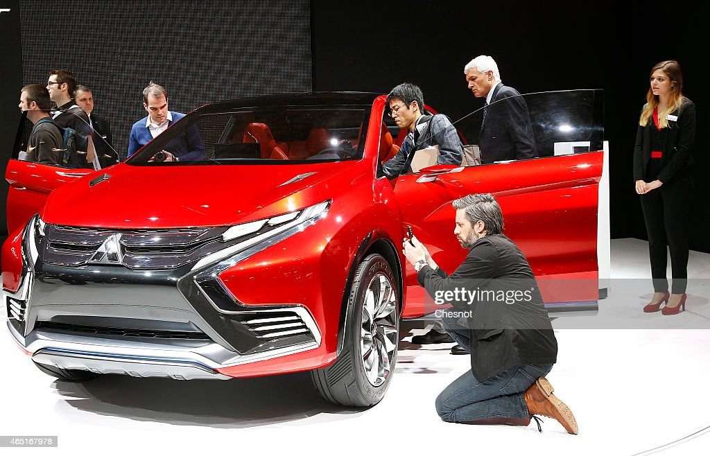 A visitor takes a picture of a Mitsubishi concept car XR phev II during the press day at the 85th Geneva International Motor Show on March 3 2015 in...