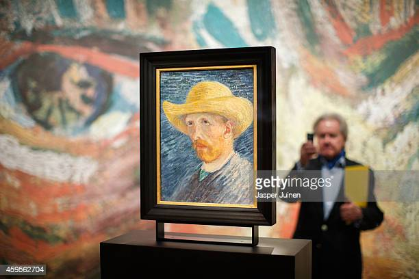 A visitor takes a picture of a self portrait of Dutch PostImpressionist painter Vincent van Gogh on the ground floor of the Vincent van Gogh museum...