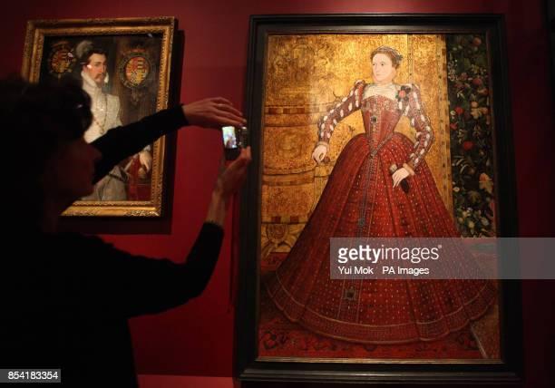 A visitor takes a picture of Hampden Portrait of Elizabeth I attributed to Steven van Herwijk or Steven van der Meulen c1560 on display at the...