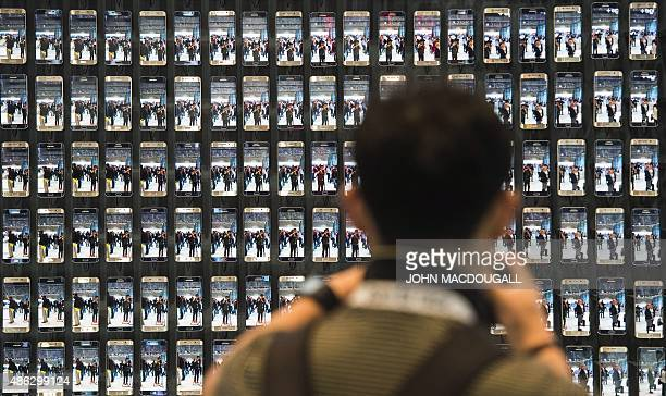 Visitor takes a picture of numerous Samsung Galaxy S6 edge smartphones at the booth of South Korean electronics giant Samsung ahead of the opening of...