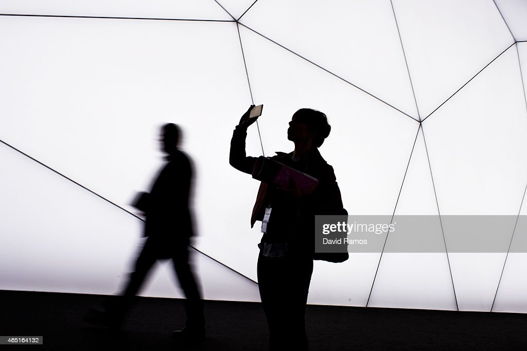 A visitor takes a picture with her phone during the second day of the Mobile World Congress 2015 at the Fira Gran Via complex on March 3 2015 in...