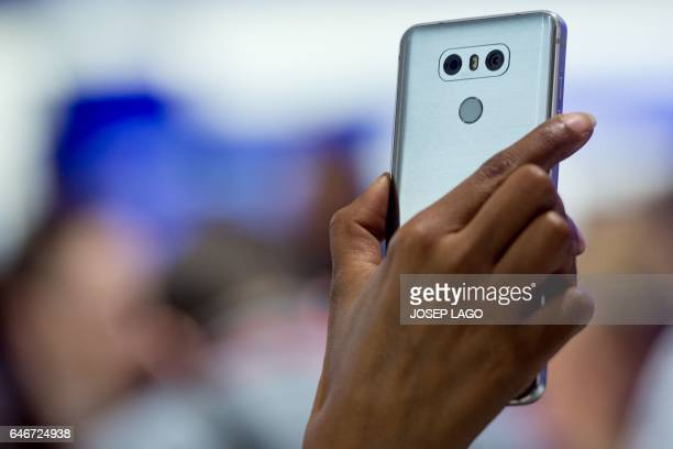 A visitor takes a picture with the Dual rearfacing cameras located on the back of a LG G6 smartphone manufactured by LG Electronics Inc during the...