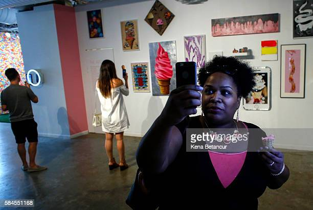A visitor takes a pictures as she visits the new Museum of Ice Cream across from the Whitney Museum on July 29 2016 in New York City The temporary...